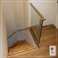 Glazen-balustrade-overloop-laswerk